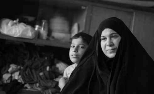 In August 2007, masked assailants stopped the van carrying Um Ali's family at a fake checkpoint on the highway to Kirkuk from Baghdad. After removing her and four of her children from the vehicle, the assailants kidnapped her husband and 18-year-old son. Three years later, she has been reduced to living in a small shack, clinging to the hope that her husband and son are alive.  Credit: Samer Muscati/Human Rights Watch