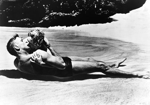 This iconic image of Deborah Kerr and Burt Lancaster embracing on the beach is among the most memorable and beloved in film history. However, The Nation's Manny Farber is not so smitten. He feels the film is too glamorous and entertaining in light of its subject matter: the Japanese attack on Pearl Harbor. (Photo: Everett Collection)
