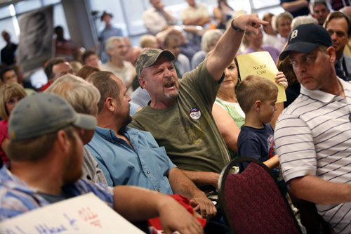 As the healthcare debate heats up over the summer, right-wingers bring their anti-government, anti-Obama aggression out in full force at town halls all around the country. Shouting at members of Congress and hurling abuse at pro-reform advocates, their often illogical rants and hate speech dominates the national discussion for weeks. AP Images
