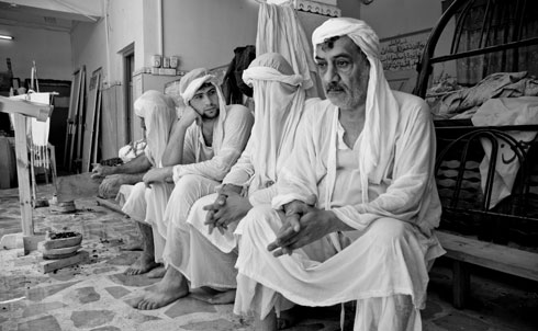 """In 2006, masked assailants blindfolded and kidnapped Naiel Thejel Ganeen, a leader of the Sabian Mandaean community. He says his kidnappers kept referring to him as an infidel and tortured him for nine days until they received a ransom of $40,000. His right arm is scarred from shrapnel after the kidnappers shot live rounds of ammunition during a mock execution. Since 2003, community leaders say attacks against the Sabian Mandaean population in Basra has resulted in their exodus—only 1,400 remain today from 3,500 in 2003. """"The extremists considered us as part of the occupation though we've been in Iraq since before it was a country,"""" Ganeen said. """"Most of our community has fled Iraq and will never return.""""  Credit: Samer Muscati/Human Rights Watch"""