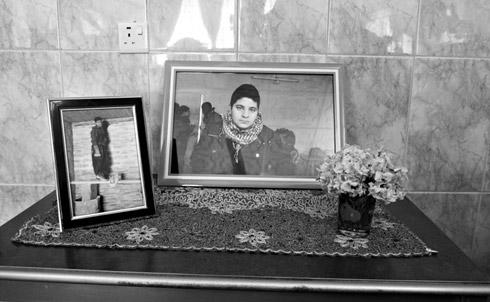 Rezhwan Ali's portrait in his family's house in Sulaimaniya