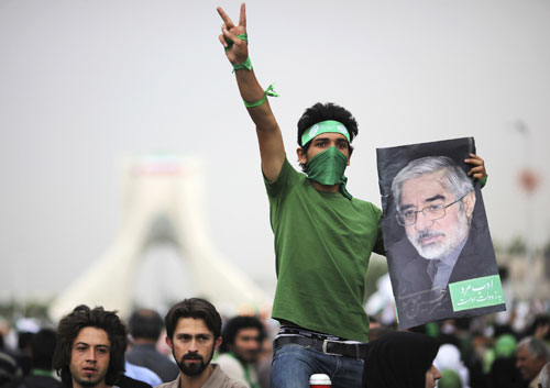Before the polls even close the Iranian government declares Ahmadinejad the victor by a suspiciously large margin. There are immediate accusations of election fraud; thousands of Iranians flood the streets to express their dismay. [Reuters Pictures]