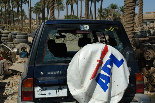 """Mohammed Kinani's car after the Nisour Square shooting. """"My car was hit many times in different places,"""" he remembers. """"All I could hear from my car was the gun shots and the sound of glass shattering."""" Photo courtesy: Mohammed Kinani"""