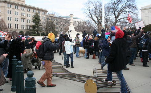 Protesters tore down metal barriers Supreme Court Police built to keep them out.