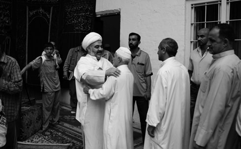 Senior cleric Sheikh al-Khalisi (left) greets parishioners after noon prayers in a mosque near the shrine of Imam al-Kadhim in the historic Kadhimiya neighborhood of Baghdad on April 23, 2010. At that moment, simultaneous bombs targeting other Shiite mosques in Baghdad killed more than 60 and injured 180, most of them Shiites who had gathered for the weekly Friday prayers.   Credit: Samer Muscati/Human Rights Watch