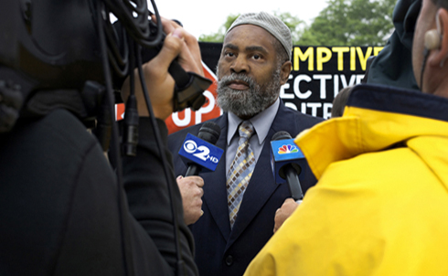 """The Masjid al-Ikhlas mosque's Imam Muhammad was the first person to publicly define the Newburgh Four case as entrapment. Had the Newburgh Four not met Shahed Hussain, in Muhammad's words, """"these men would still be smoking weed and drinking beer somewhere."""" Documents revealed during the Newburgh Four trial show that the FBI considered Imam Salahuddin Muhammad and other members of the mosque to be persons of interest. Imam Salahuddin Muhammad was awarded the 2010 Human Rights Award by Orange County officials, in recognition of his community engagement and work as a chaplain to Muslim inmates in the New York State Correctional System.  © Lyric R. Cabral 2010"""