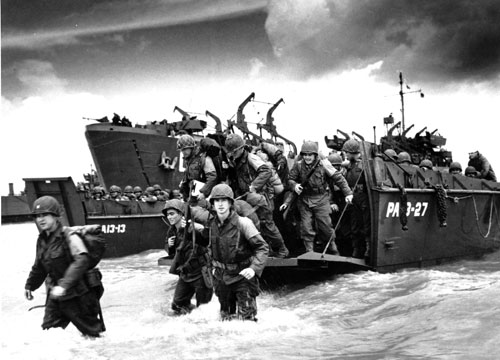 After nearly two years of crippling defeats, the tide turns as American reinforcements arrive on the beaches of Normandy on June 6, 1944--D-Day. While this allied victory over the Nazis is celebrated as the beginning of the end of the war in Europe, there is a lingering fear that the worst is yet to come.  [AP Images]