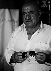 Zahir Khardaghi holds his son's sunglasses