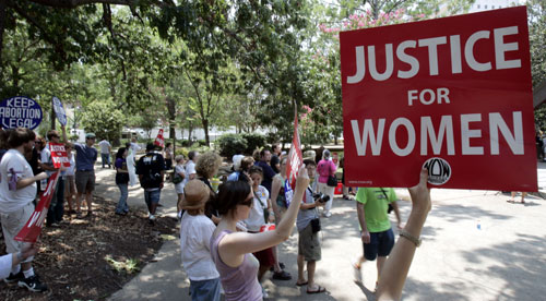 Progressives consider healthcare reform's narrow passage in the House a major victory. But supporters of women's rights suffer a serious blow when conservative Democrat Bart Stupak tacks on an amendment that prevents any healthcare plan financed in any part by affordability credits from covering abortion care.[AP Images]