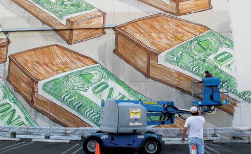 "Most recently, another whitewashing in Los Angeles: the Italian street artist Blu created a massive mural on the wall of MOCA's Geffen Contemporary building to promote the upcoming ""Art in the Streets"" exhibit, only to have the museum paint it over less than 24 hours later. MOCA director Jeffrey Deitch deemed the grid of coffins draped with flag-sized dollar bills insensitive, but many others in the art world saw the self-censoring move as an overreaction damaging to the institution's credibility.