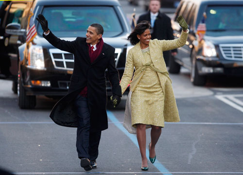 The President and First Lady walk down Pennsylvania Avenue. (Reuters Photos)