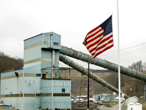 The American flag flies at half-staff in the wake of a mining disaster at coal processing plant in West Virginia. Nation contributor Ari Berman explores the coal industry's commitment to sustainability and finds the evidence less than encouraging. (Reuters Pictures)