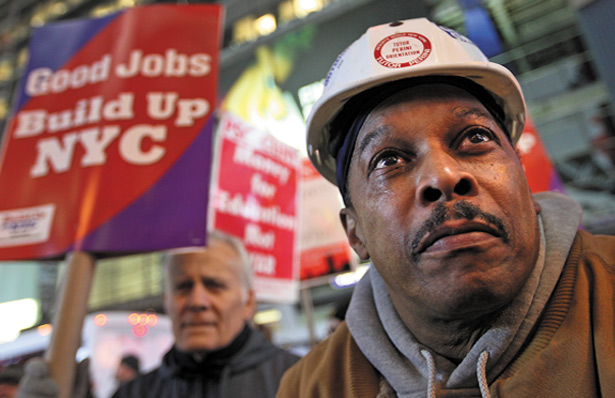 Low-wage workers rally for better pay in Times Square.