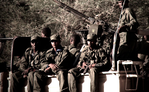 "Ras Kamboni fighters on a ""technical,"" a pick-up truck equipped with a heavy weapon, near Dhobley, Somalia.