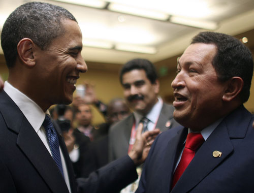 "Also at the Summit of the Americas, Obama reaches out to controversial Venezuelan president Hugo Chávez and is warmly received. After nearly a decade of strained relations, Chávez declares a ""new era"" has begun and pledges to send an ambassador back to the US to begin re-establishing diplomatic relations. (Reuters Pictures)"