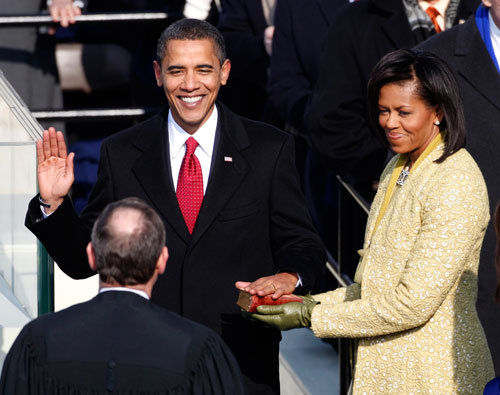 Obama takes the oath of office, administered by US Chief Justice John Roberts. (Reuters Photos)