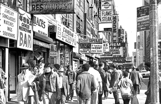Shoppers hustle down 42nd Street in 1975.