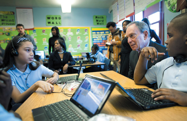 Mayor Michael Bloomberg observes fifth graders at Brooklyn's Public School 262.