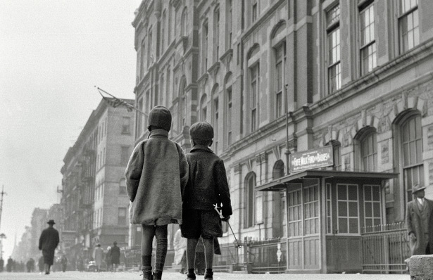 Two children absorb the images and sounds of Harlem in 1943