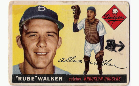 """Third-string catchers are rarely anybody's hero, but Rube Walker was and remains one of mine. With his ever-present chaw of tobacco and a drawl as Southern as frost on cotton leaves, he was a throwback to the rural poverty of America in the first half of the twentieth century. He had a heart as big as a locomotive, full of compassion, generosity and understanding. He helped the community's poor; he taught young players and counseled old ones; he was a jovial encourager to everyone. In so doing, he taught us what it was to be a """"big leaguer,"""" in the best, most noble sense of the term.  Dan Rather, the former news anchor for CBS Evening News, is the managing editor and anchor of the TV newsmagazine Dan Rather Reports on HDNet.   Credit: The Topps Company Card image courtesy of Marck Bacontowne"""