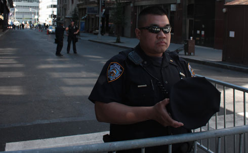 A police officer guards the barricade in front of the proposed Park51 cultural center (background).  This block of Park Place was off-limits to the public on September 11, 2010.