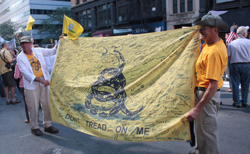 True to Tea Party form, protesters evoked the legacy of American colonialists, with a message of distrust for central government. 