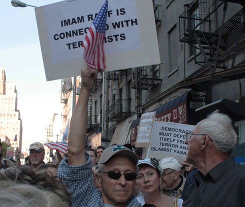 Some protesters held signs accusing Imam Feisel Abdul Rauf, sponsor of the Park51 project, of terrorist connections, and conflating Islam with totalitarianism and terrorism in general.