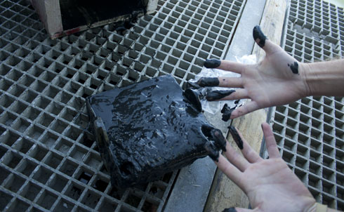 """At several more research stations near BP's wellhead, the WeatherBird II finds the ocean floor coated in similar muck. The closer the boat gets to the wellhead, the more black matter there is in the sediment. And Hollander is disturbed. The abnormal layer of sediment is up to five times thicker than it had been when he collected samples here in August. The oil's presence on the ocean floor didn't diminish with time; it grew. And, he points out, """"the layer is distributed very widely,"""" radiating far out from the wellhead.  Credit:Brian Zelinski"""