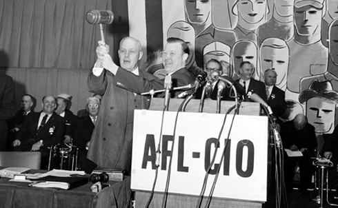 George Meany, left, and Walter Reuther pronounce the merger of AFL and CIO