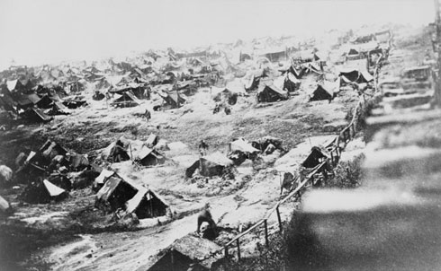 """As Reconstruction began in the post-war South, the hidden atrocities of the war between the states started to come to light. In one 1866 piece, """"Welcome to Andersonville,"""" the editors of The Nation describe the brutal conditions at that notorious Confederate prisoner of war camp, where men lay """"partially naked, dirty and lousy in the sand, wasting under gangrene, putrid from fever-sores, and literally dying from starvation.""""  Library of Congress"""