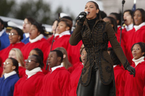 """Beyoncé electrifies the crowd during the """"We Are One: Opening Inaugural Celebration at the Lincoln Memorial.""""  (AP Photo/Carolyn Kaster) Read more about the inaugural concert featuring Beyoncé here."""
