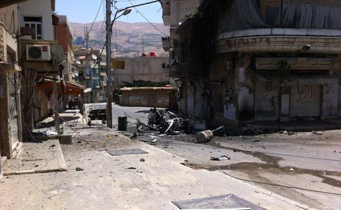 A car hit by a shell in the Hara neighborhood of Zabadani