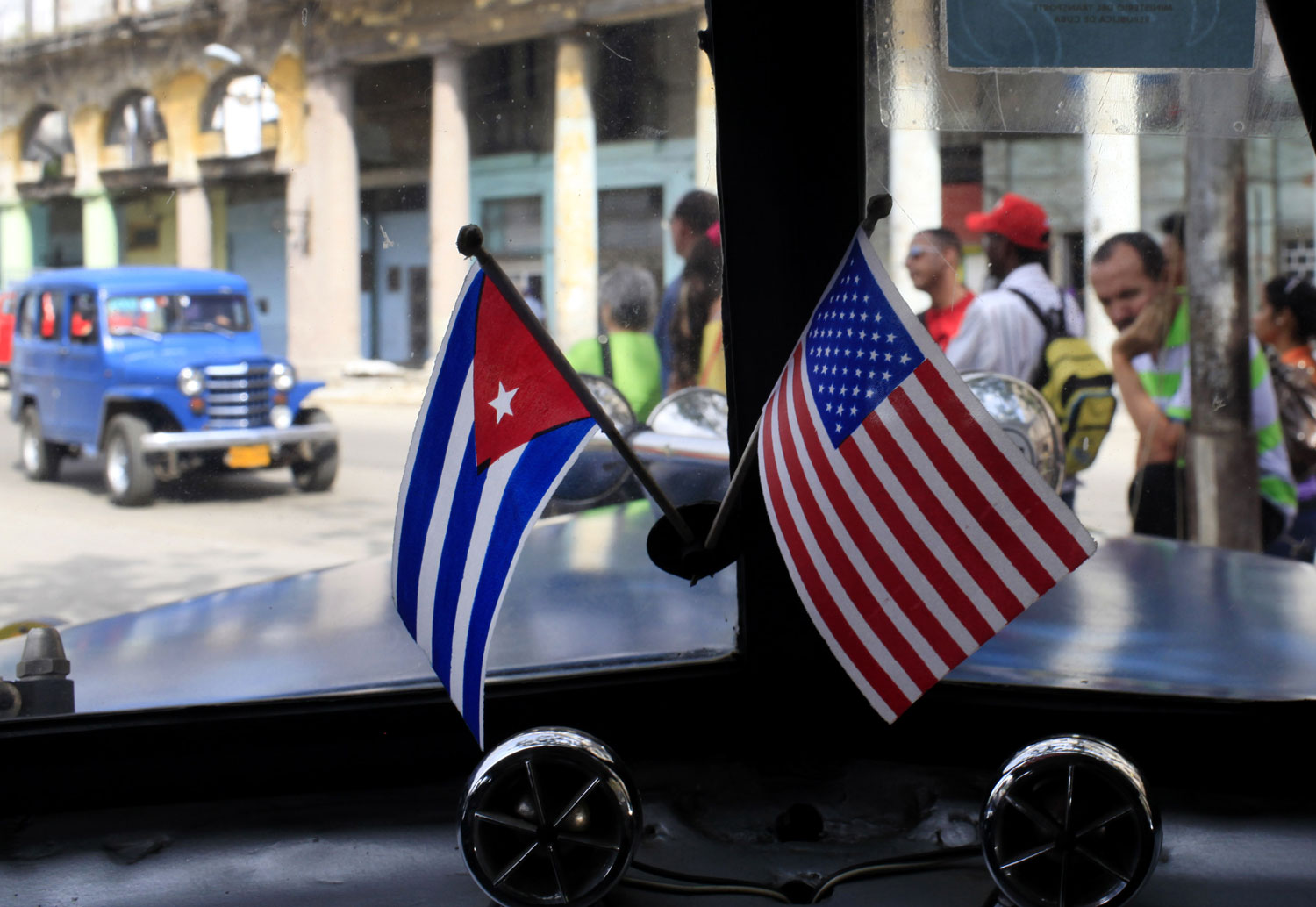 Miniature-flags-representing-Cuba-and-the-US-are-displayed-on-the-dash-of-a-car-in-Havana-Cuba.-AP-PhotoFranklin-Reyes