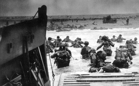"""In the aftermath of D-Day and the establishment of a beachhead on the coast of France, the end is in sight for Germany. The Nation reports that Hitler's """"old nightmare has become grim reality"""" as his forces are encircled and forced to fight on five fronts. """"Where…shall he throw his reserves?"""" The Nation asks, """"how far can he strip his home garrisons when Germany harbors ten million foreign slaves waiting a chance to break their bonds?""""  Everett Collection"""