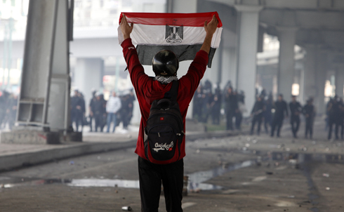 """On Monday, January 31, protesters took to Egypt's streets for a seventh day, demanding an end to President Hosni Mubarak's 30-year reign. The broad coalition of students, labor activists, lawyers, intellectuals and Islamists behind the unrest is now calling for a massive protest in Cairo for Tuesday and the Egyptian military has announced that it has ruled out the use of force against protesters.  """"This is not Hosni Mubarak's Egypt anymore,"""" says Sharif  Kouddous, reporting from Cairo. """"And no matter what happens next, it will never be again.""""  Credit: Reuters Pictures"""