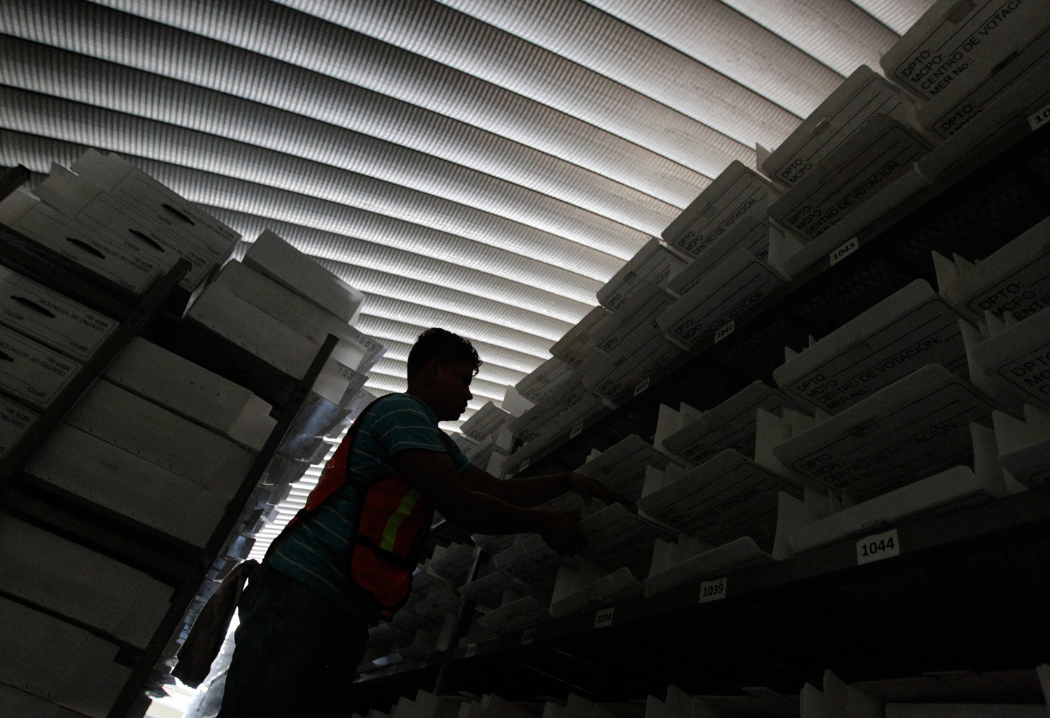 An-employee-of-the-Honduras-Supreme-Electoral-Tribunal-arranges-voting-materials
