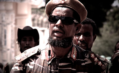 "Yusuf Mohamed Siad, known by his nom du guerre ""Indha Adde,"" or White Eyes, was once a key ally of Al Qaeda and the Shabab. Today, the notorious warlord is a three-star general in the Somali military and receives weapons and support from the US-trained, armed and funded African Union force, AMISOM. A rival warlord, once heavily supported by the CIA, charges that Indha Adde and other warlords now fighting on the US side are playing Washington and the Somali government in an effort to keep their strongholds.