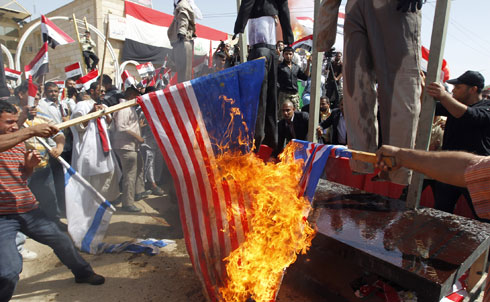 """In 2004, five years before this photo was taken, Jonathan Schell wrote about the first anniversary of the American invasion of Iraq, describing the country as """"far from being a model for anything…a cautionary lesson in the folly of imperial rule in the twenty-first century."""" The article, """"The Empire Backfires,"""" views the Iraq war as an """"indispensable"""" part of a larger policy of American hegemony that doesn't realistically add up.  Reuters Pictures"""