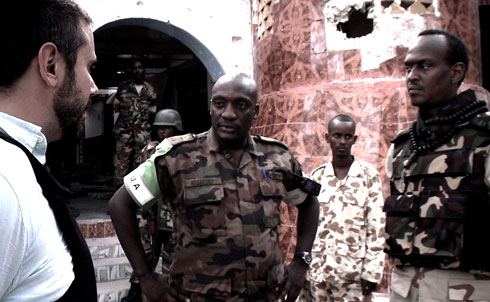 "A Ugandan AMISOM commander outside of an ASWJ mosque recently retaken from Al Shabab. AMISOM forces work closely with various militias. ""The resort to Somali proxy forces by foreign Governments represents a potential return to the 'warlordism' of the 1990s and early 2000s, which has historically proved to be counterproductive,"" the UN concluded in a recent report on Somalia.