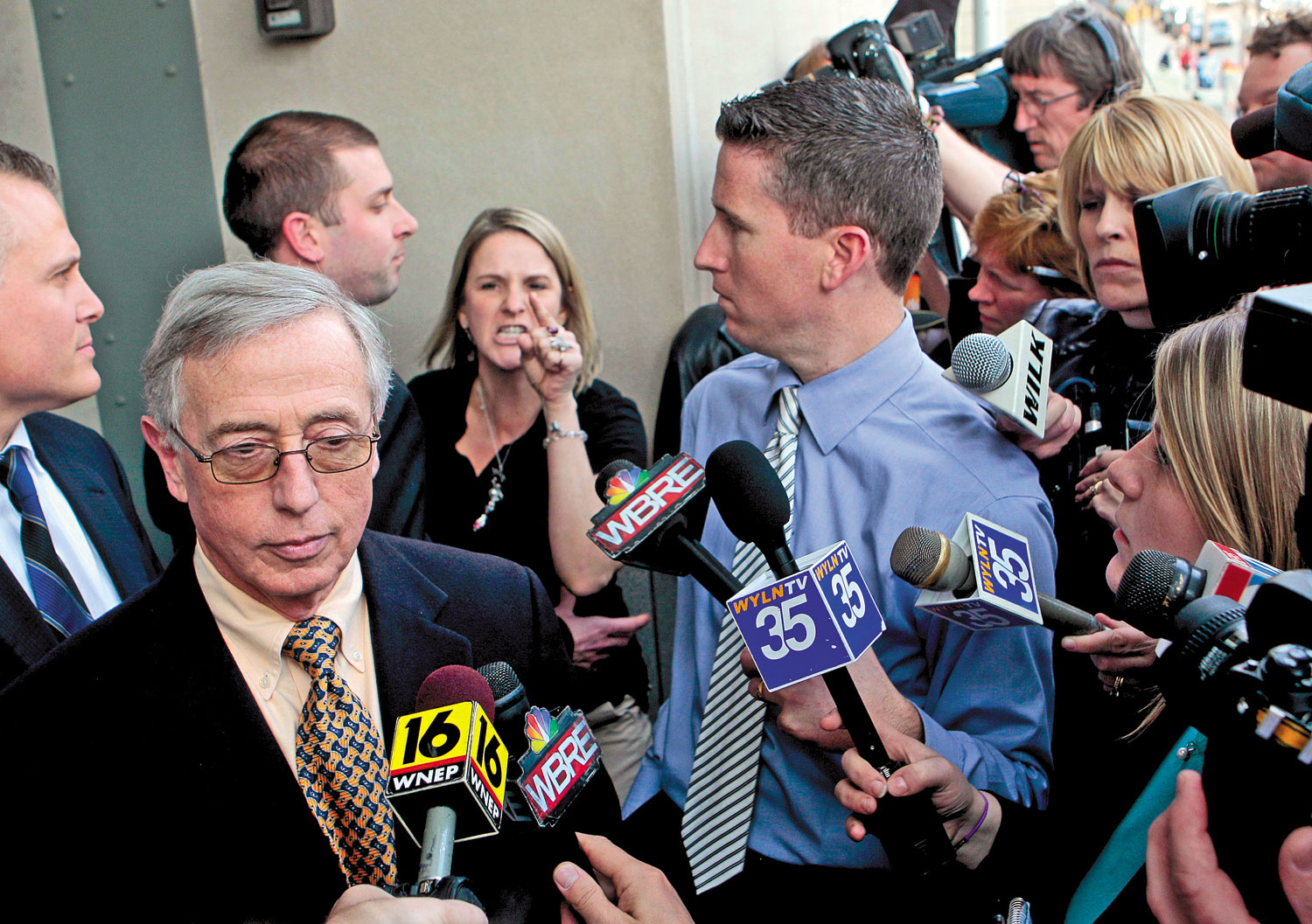 Mark-Ciavarella-left-and-Sandy-Fonzo-center-outside-a-courthouse