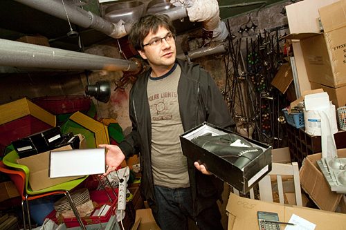 By the end of 2008, Valdis Novikovs had lost his job as a plumber's assistant. He now helps bankrupt businesses sell off their material assets. One of his three storage units was packed to the ceiling with more than 800 pairs of imported shoes that used to sell for $40 and sold for just $5 a pair in May. The volume of his sales is increasing every month.