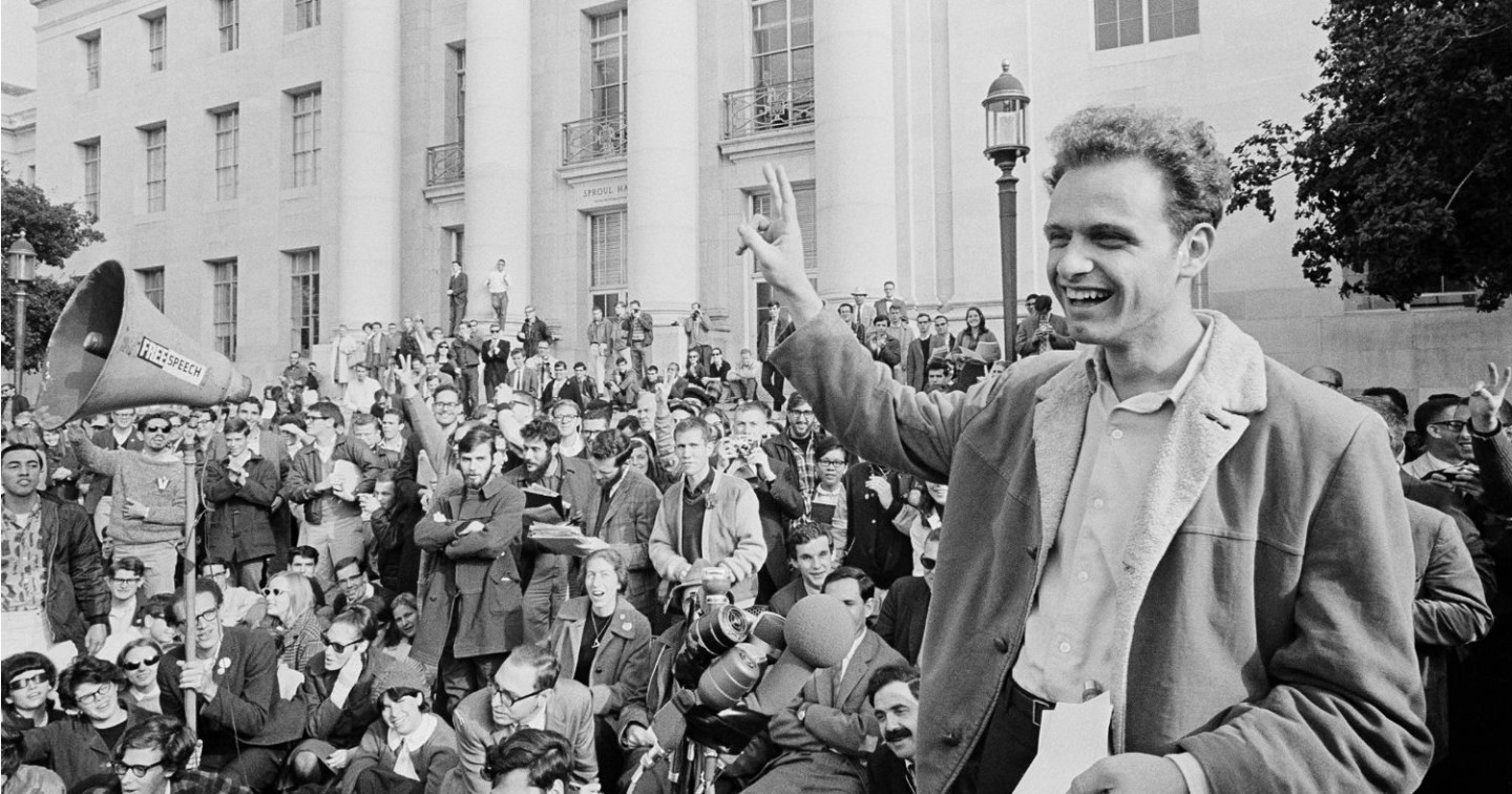 Mario Savio greeting a crowd of Free Speech Movement supporters at Cal-Berkeley.