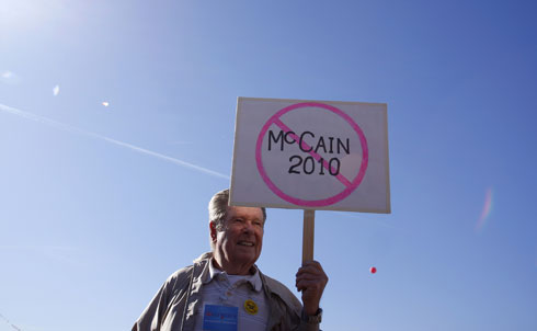 """McCain's lead in the primary may be safe, but he's achieved it by alienating his more moderate base. The McCain running in this year's race is far removed from the maverick senator who once co-sponsored a relatively liberal immigration bill with the late Ted Kennedy. Now he's urging accelerated construction of a wall at the border, advocating deportation and appearing in TV ads with an extremist leader of the campaign to defend SB 1070. But McCain's race to the right has done little to win over the state's utlra-conservatives.  """"Indeed, it speaks volumes to the estrangement between McCain on the one hand and his own party and its base on the other that Hayworth could ever, even briefly, be considered little more than marginal amusement,"""" Cooper writes. """"In what political universe does a defeated former congressman seriously challenge a long-incumbent senator, a former presidential candidate?""""  Credit: Reuters Pictures"""