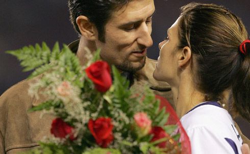 The hyper-heterosexual portrayal takes a well-known female athlete and explicitly links her to traditional heterosexual roles, such as girlfriend, wife or mother.  Mia Hamm, former Olympian and professional soccer player with husband Nomar Garciaparra  Credit: Getty Images/Lisa Blumenfeld