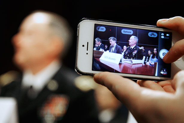 A-reporter-takes-a-mobile-phone-picture-of-National-Security-Agency-NSA-Director-Reuters