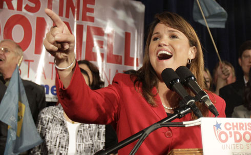 In one of this season's biggest primary upsets, anti-masturbation activist, Sarah Palin-lookalike and former witchcraft enthusiast turned Halloween hater Christine O'Donnell beat incumbent Republican Representative Mike Castle for the GOP's nomination for Senate in Delaware. After a big push from her Tea Party base and seemingly decisive backing from Palin, O'Donnell's win placed the extremely conservative candidate in the spotlight of a national debate about the viability of the Republican party's rightward swerve. So far, says Leslie Savan, the Democrats have been delighted that O'Donnell, and not the popular, moderate Castle, will face Democratic senate nominee Chris Coons in November. A recent poll suggests that O'Donnell trails Coons by a significant margin, 53 to 36 percent.  Credit: AP Images