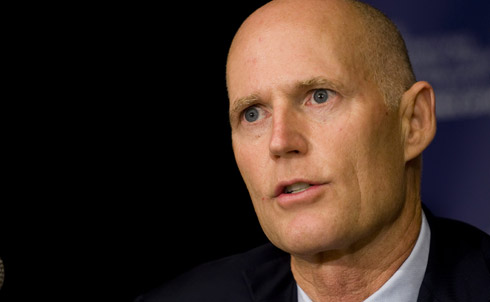 "It only took Rick Scott six months to become literally the least popular governor in America, and it's not hard to see why. In no particular order, Scott has: cut unemployment benefits, killed a popular high-speed rail project, privatized the state's Medicaid program, slashed funds for the developmentally disabled, mandated that all state workers be subject to random drug testing, tried to disband the Florida Highway Patrol and took a ""wrecking ball"" to the state's public education system.