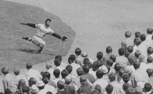 """Three seconds of seeing him move at long distance on a tiny black-and-white TV set, and you could tell who it was. He would work his neck and shoulders constantly in the on-deck circle, then step haughtily into the batter's box, slash at a """"bad"""" pitch, hit a screaming line drive, then run the bases like a madman. Or make a basket catch in right field and throw a rope to the plate to beat the runner tagging up and trying to score.  John Sayles is a filmmaker and the author, most recently, of A Moment in the Sun (McSweeney's).  Credit: AP Images"""