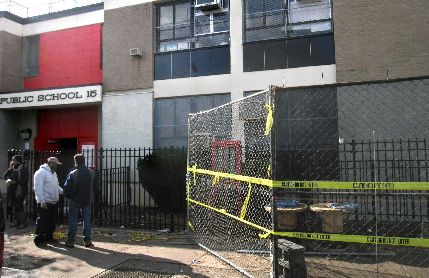 In-the-weeks-following-Hurricane-Sandy-apartment-buildings-and-schools-across-the-Red-Hook-section-of-Brooklyn-were-left-without-power.-AP-PhotoBeth-Harpaz