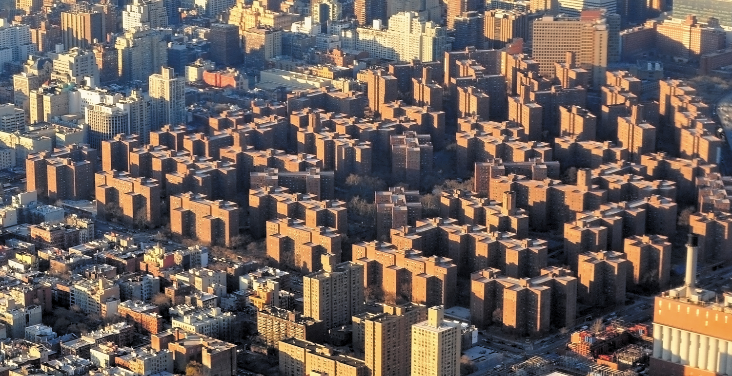 Stuyvesant-Town–Peter-Cooper-Village-as-seen-from-the-air-over-the-East-River-New-York-City